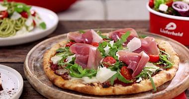 Keine Lust, selbst den Kochlöffel zu schwingen?Lieferheldbringt dir Pizza, Pasta und Co. bis an deine Haustür!Mit dem Lieferheld Gutschein wird dein Lieblingsessen jetzt 5€ günstiger– egal, ob du Neu- oder Stammkunde bist.